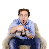 Man holding several TV remotes