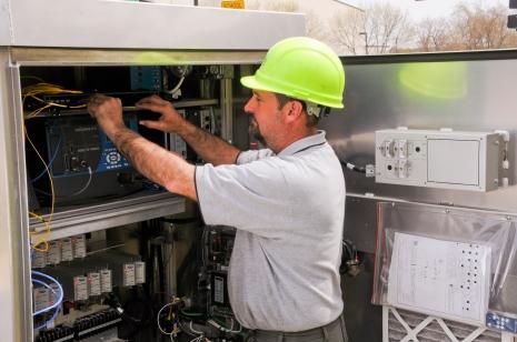 ImOn Employee working on equipment image